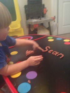 Making letters out playdough