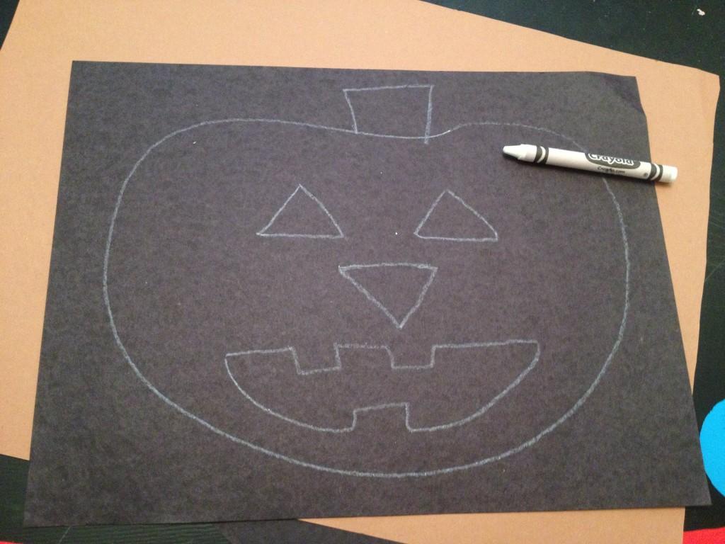 jack-o-lantern on black paper